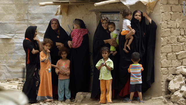 Iraqi women and children at the Chikouk camp for the internally displaced in northwestern Baghdad on July 21, 2009.