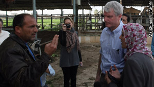 Rep. Brian Baird speaks to a Palestinian man during his latest visit to Gaza, still reeling from the 2009 incursion.