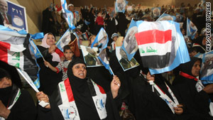 Iraqis wave flags at a campaign rally Sunday in Baghdad.  The general election is set for March 7.