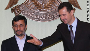 Presidents Mahmoud Ahmadinejad, left, of Iran and Bashar Assad of Syria meet Thursday in Damascus.