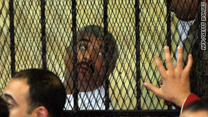 Egyptian tycoon Hisham Talaat Mustafa inside the defendants' cage during his trial in Cairo.