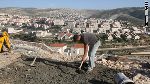 A man works at a Jerusalem contruction site. On Tuesday, the U.S. denounced plans to build similar housing.