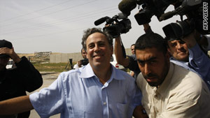 Paul Martin is pursued by the media after his release by Hamas
