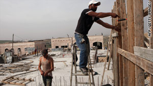 Palestinian laborers work on a construction site in Jerusalem  on March 11, 2010.