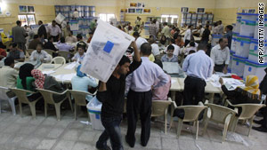 Staffers count ballots in Baghdad, Iraq, on Sunday.