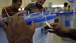 Iraqis count and sort votes in Baghdad on Tuesday.