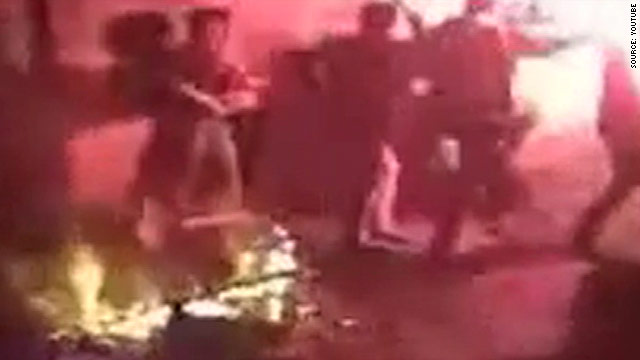 Video posted on YouTube shows young men dancing around a bonfire in the street in the lead up to the Iranian New Year.