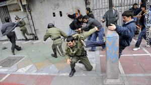 Iranian opposition protesters clash with security forces in Tehran on December 27.