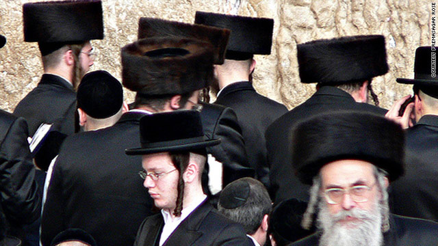 "Ultra-orthodox Hassidim at the Western Wall in Jerusalem. The bill to ban fur in Israel includes a ""cultural exception"" allowing them to continue wearing the tall, furry ""shtreimel"" if the bill were to become law."