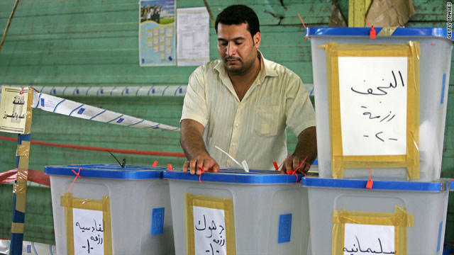 An Iraqi electoral worker with ballot boxes at a counting center in Baghdad, Iraq on March 17, 2010.