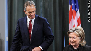 U.N. Middle East envoy Tony Blair takes his place next to Secretary of State Hillary Clinton on Friday in Moscow.