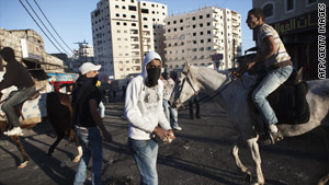 Palestinian youths gather Saturday in East Jerusalem, where clashes with the Israeli military have plagued the streets.