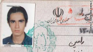 A passport image of Ramin Ramezani, whose parents say they just want his killers to be punished.