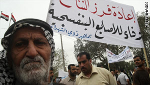 Iraqi demonstrators call for a recount of votes from the general election during a protest in Basra on Wednesday.