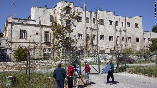 A camera crew stands outside the former Shepherd Hotel in East Jerusalem, which will be torn down for new housing.