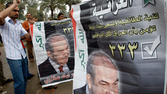 Supporters of Premier-elect Ayad Allawi carry his picture as they celebrate his party's victory in Baghdad.
