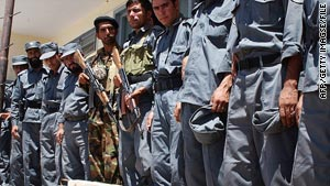 Afghan border policemen stand guard by landmines discovered near the Iranian border in 2007.