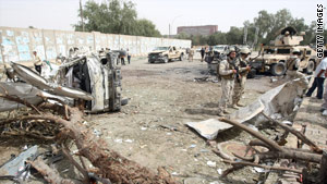 Debris litters the ground at the site of an explosion near the Iranian Embassy in Baghdad, Iraq, on Sunday.