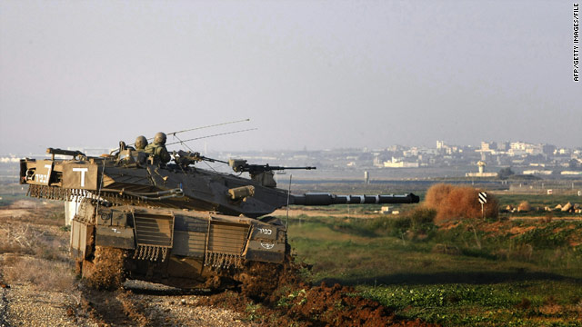 An Israeli tank takes up a position near the Israel-Gaza border in December 2008.