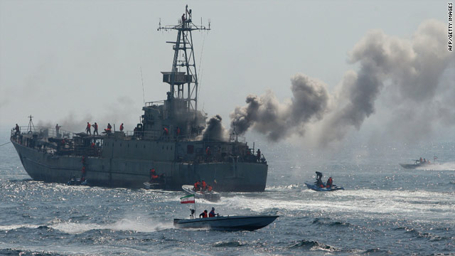 Iran's elite Revolutionary Guard practice attacking a naval vessel  during military exercises in the Persian Gulf.