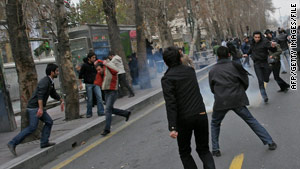 Demonstrators clash with Iranian security forces during a December rally in Tehran.