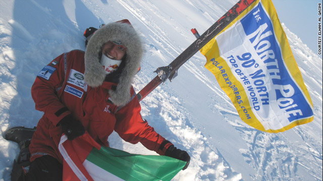 Emirati woman Elham Al Qasimi plants a flag at the geographic North Pole.