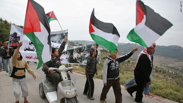 Palestinians and foreign peace activists protest Friday against Israel's separation barrier in the West Bank.
