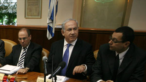 Israel Prime Minister Benjamin Netanyahu, center, chairs the weekly Cabinet meeting Sunday in Jerusalem.