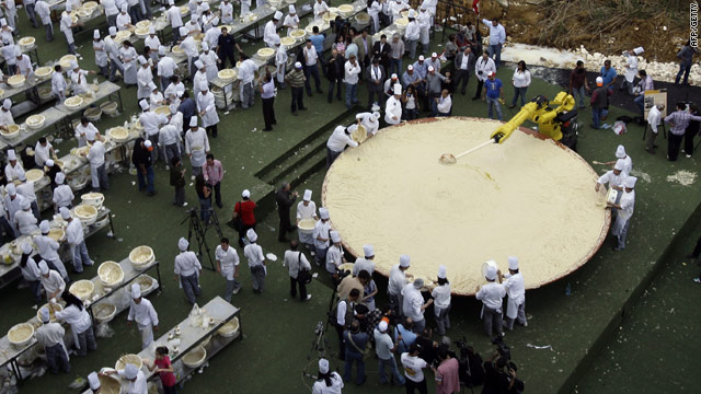 The world's largest plate of hummus weighs 11.5 tons and was created Saturday by 300 Lebanese chefs.