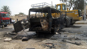 A bus devastated in a suicide bomb attack Monday south of Baghdad.