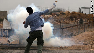 A Palestinian protests near Ramallah in the West Bank last month. On Friday a Palestinian teen was shot dead.