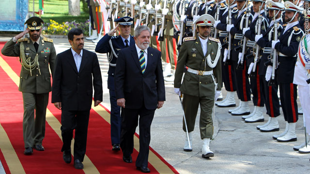 Iranian President Mahmoud Ahmadinejad and Brazilian counterpart Luiz Inacio Lula da Silva review an honor guard in Tehran.