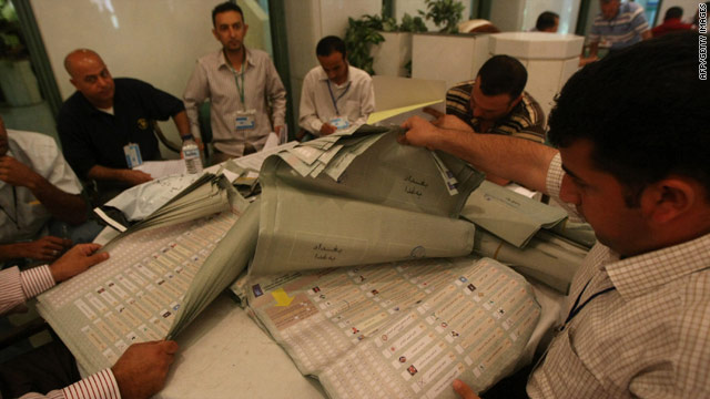 Workers recount ballots May 7 in Baghdad, Iraq.  Officials said Sunday the results were unchanged in Iraq's largest province.