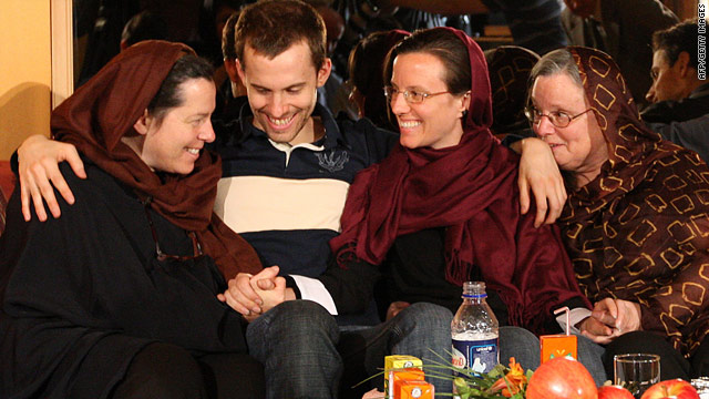 Detained U.S. hikers Shane Bauer and Sarah Shourd, second from right, are reunited with their mothers in Tehran, Iran.