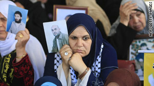 Palestinian women take part in a protest in Gaza City on May 24, 2010 to demand the release of Palestinian prisoners held in Israeli jails