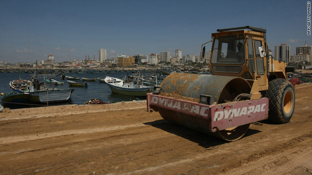 Palestinian workers prepare Gaza City's port to receive ships expected to break Israel's naval blockade.