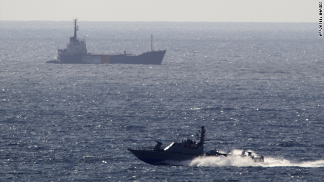 An Israeli navy boat escorts the Rachel Corrie aid ship, back, as it enters the Israeli military port of Ashdod on Saturday.