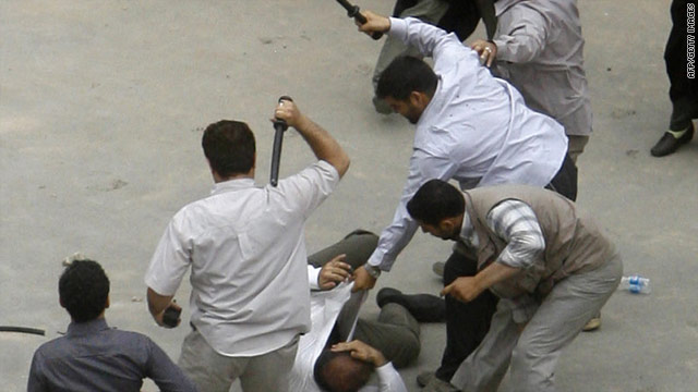 Iranian plain clothes policemen beating a demonstrator with batons during a protest against the election results on June 14, 2009.