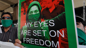 An Iranian in Japan holds a placard during a rally of about 30 people near the Iranian Embassy in Tokyo