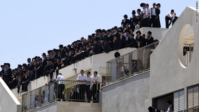 Ultra-Orthodox Jews watch the rally in the central city of Bnei Brak on June 17, 2010.