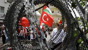 Protesters wave the Palestinian flag while protesting in Turkey earlier this month.