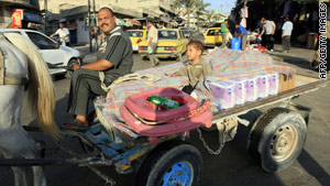 A Palestinian street vendor rides his cart in Gaza on June 17, the day Israel said it would ease a blockade of the territory.
