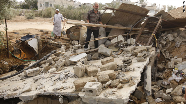 Palestinians  inspect the aftermath of an Israeli airstrike on Rafah in Gaza. The Israeli military said the attack was in response to mortars fired into Israel.