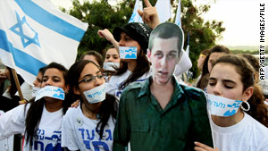 Israeli supporters call for the release of Gilad Shalit, pictured in cardboard cutout.