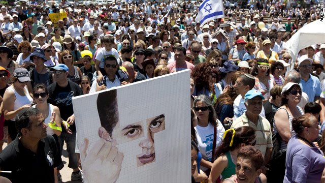 Advocates for the release of abducted Israeli soldier Gilad Shalit rally Friday in Netanya, Israel.