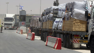 Trucks loaded with goods for Gaza line up at the Kerem Shalom terminal last month.