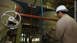 A technician works at a nuclear processing facility near the Iranian city of Qom.