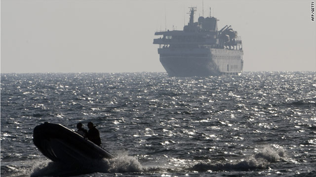 A speed boat escorts Turkish ship Mavi Marmara with Israeli troops on board near Ashdod, Israel, on May 31.