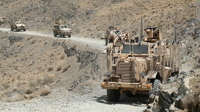U.S. troops drive through a valley in Afghanistan last week on a mission to clear improvised explosive devices.