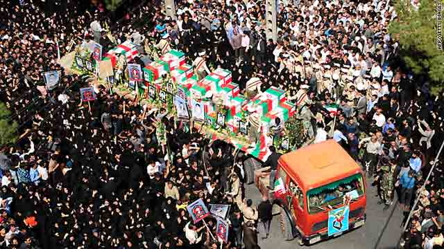 Iranian mourners on Saturday attend the mass funeral of those killed in twin suicide bombings in Zahedan.